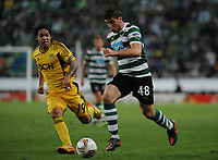 20120329: LISBON, PORTUGAL - Football - UEFA Europe League 2011/2012 - Quarter-finals, First leg: Sporting CP vs Metalist<br /> In picture: Sporting's Emiliano Insua, from Argentine, rigth, fights for the ball with Metalist's Juan Manuel Torres, from Argentine.<br /> PHOTO: Alvaro Isidoro/CITYFILES