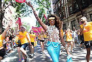 Lashauwn Beyond, of Fort Lauderdale, FL, a finalist in RuPaul's Drag Race and the face of the Greater Fort Lauderdale Convention & Visitors Bureau LGBT campaign, marches in the New York Gay Pride Parade, Sunday, June 29, 2014.  (Photo by Diane Bondareff/Invision for Greater Fort Lauderdale Convention & Visitors Bureau/AP Images)