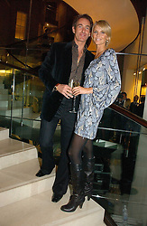 MALIN JOHNANSSON and TIM JEFFERIES at a Christmas party to celebrate the 225th Anniversary of Asprey held at their store 167 New Bond Street, London on 7th December 2006.<br />