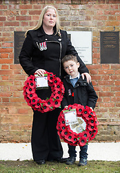 © London News Pictures. Rebecca Rigby the widow of Fusilier Lee Rigby and their son Jack prepare to lay wreaths at a new memorial in St George's Chapel to those from the Borough who lost their lives in Service since the end of WW2.  Fusilier Rigby is one of eleven men named on the memorial in the ruins of the Royal Artillery Garrison Church. Photo credit: Rupert Frere/LNP