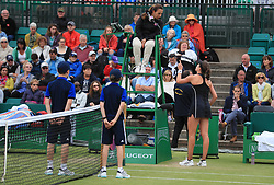 Johanna Konta argues with umpire Paula Vieira Souza during her WTA Singles Final match with Ashleigh Barty during day seven of the Nature Valley Open at Nottingham Tennis Centre.