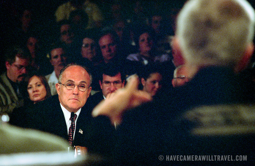 "Rudolph ""Rudy"" Guiliana, Mayor of New York City, testifying at the 9/11 Commission's 11th Public Hearing in New York City. Bob Kerrey is in the foreground, seen from behind."