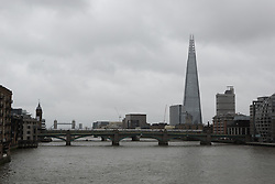 © Licensed to London News Pictures. 29/05/2015. London, UK. Wet and overcast weather is seen looking down the River Thames in London today. Today is the first day of British Summer Time (BST).  Photo credit : Vickie Flores/LNP