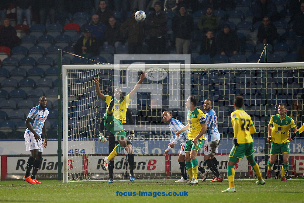 Cameron Jerome of Norwich clears the ball during the Sky Bet Championship match at the John Smiths Stadium, Huddersfield<br /> Picture by Paul Chesterton/Focus Images Ltd +44 7904 640267<br /> 17/03/2015