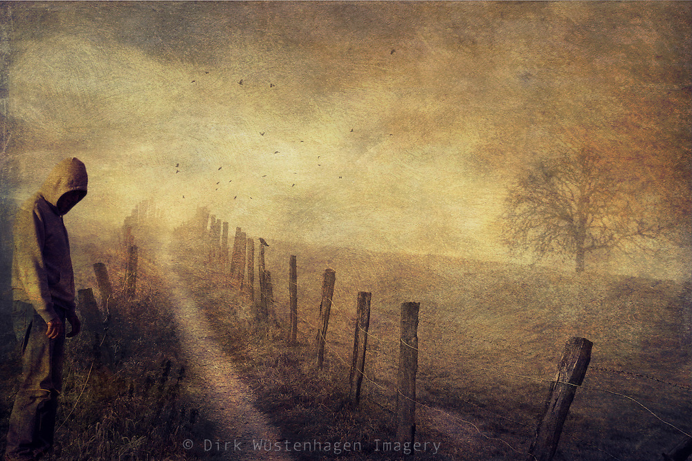 Surreal foggy landscape. A path through fields & a man indecisive...