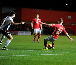 Bristol City's Joe Bryan watches his deflected shot drop in over the head of Port Vale's Chris Neal to score  - Photo mandatory by-line: Joe Meredith/JMP - Mobile: 07966 386802 - 10/02/2015 - SPORT - Football - Bristol - Ashton Gate - Bristol City v Port Vale - Sky Bet League One