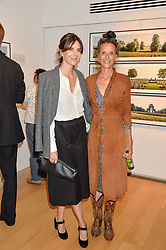 Left to right, HENRIETTA CHANNON and the MARCHIONESS OF WORCESTER at a private view of photographs by Jolyon Fenwick 'The Zero Hours Panoramas' 100 Years On: Views From The Parapet of The Somme held at Sladmore Contemporary, 32 Bruton Place, London on 30th June 2016.