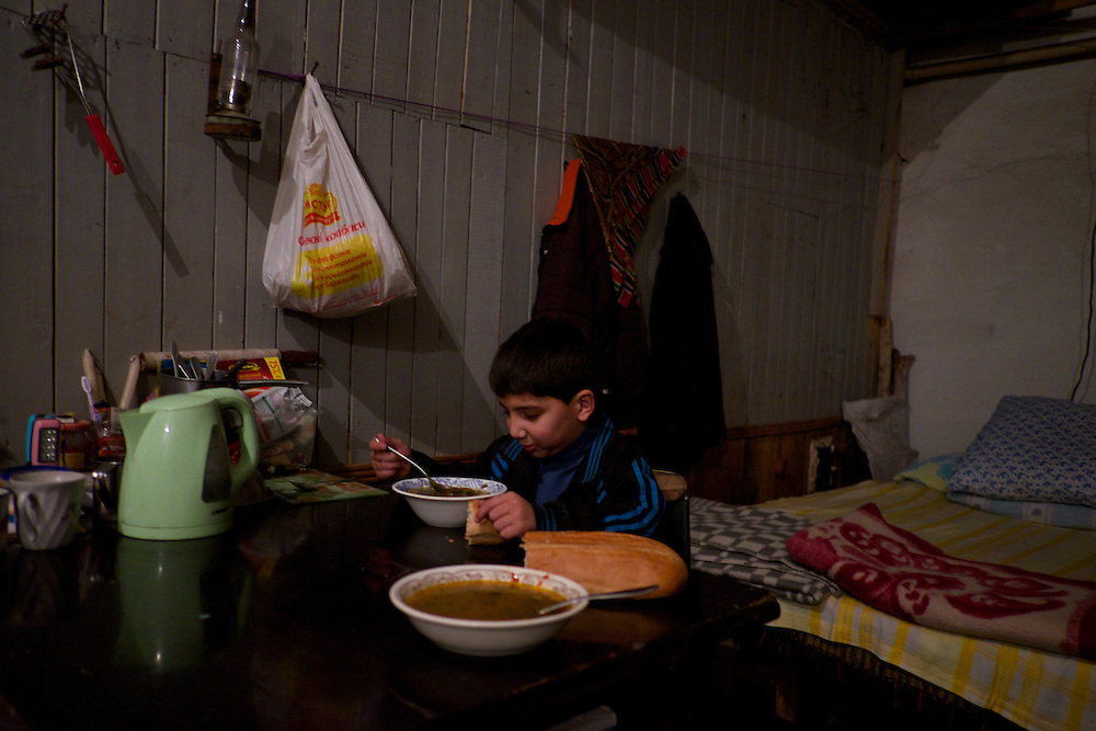 DONETSK, UKRAINE - OCTOBER 16, 2014: An IDP child eats his meal in a small room of a Soviet era bomb shelter in Petrovskiy district, Donetsk. More than one hundred people have been living for the past four months at the shelter after heavy fight broke out between DNR rebels and the Ukrainian National Guard, over the control of Donetsk. CREDIT: Paulo Nunes dos Santos