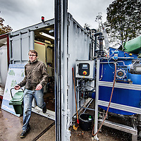 Nederland, Amsterdam, 4 november 2016.<br /> <br /> Lara van Druten is oprichter van The Waste Transformers. Dit bedrijf zet afval lokaal om in elektriciteit, warmte of groen gas. Via de Nederlandse ambassade kwam ze in contact met een belangrijke eerste klant in Durban, Zuid-Afrika.<br /> Het ministerie van Buitenlandse Zaken zet zich via de ambassades en RVO.nl in voor de belangen en kansen van het Nederlands bedrijfsleven in het buitenland.<br /> Op de foto: Managing director Lara van Druten en collega Operations Manager Jasper Körmeling aan het werk bij de waste transformer in Westerpark.<br /> <br /> Netherlands, Amsterdam, November 4, 2016.<br /> In the heart of Amsterdam, the Netherlands, at the historic site of the Westergasfabriek, the installation of The Waste Transformers converts the organic waste from ten restaurants, two theaters, a micro-brewery and a number of creative industries. This former gas coal plant and the surrounding area has been transformed into a buzzing, healthy park.<br /> The collective organic waste from the Westerpark in Amsterdam is transformed into green energy, water and fertilizer that makes the park bloom even more. Residents around the park, and in the country, can take an energy subscription on the good vibes in the park. The Waste Transformers and partners ensure that this energy is 100% local and green.<br /> On the photo: Managing Director Lara van Druten and  Operations Manager Jasper Körmeling working at the waste transformer in the Westerpark. <br /> <br /> Foto: Jean-Pierre Jans