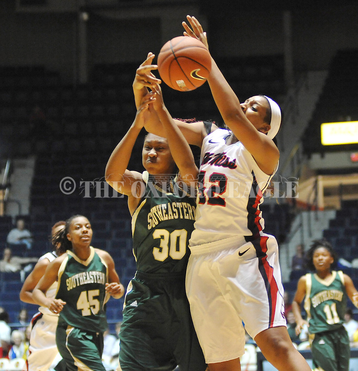 Mississippi's Monique Jackson (42) and Southeastern Louisiana's Nanna Pool (30) vie for the ball in Oxford, Miss. on Friday, November 9, 2012. (AP Photo/Oxford Eagle, Bruce Newman)