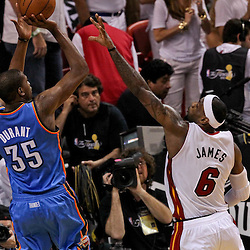 Jun 21, 2012; Miami, FL, USA; Oklahoma City Thunder small forward Kevin Durant (35) shoots over Miami Heat small forward LeBron James (6) during the second quarter in game five in the 2012 NBA Finals at the American Airlines Arena. Mandatory Credit: Derick E. Hingle-US PRESSWIRE