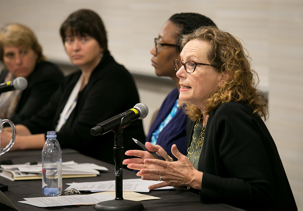 """This is a session titled """"Families on the Precipice: Navigating the Separation, Detention, and Reunification of Families at the U.S. Border""""  at the 2018 American Bar Association Annual Meeting.  Panelist Maria Woltjen speaks. photos by Kathy Anderson"""