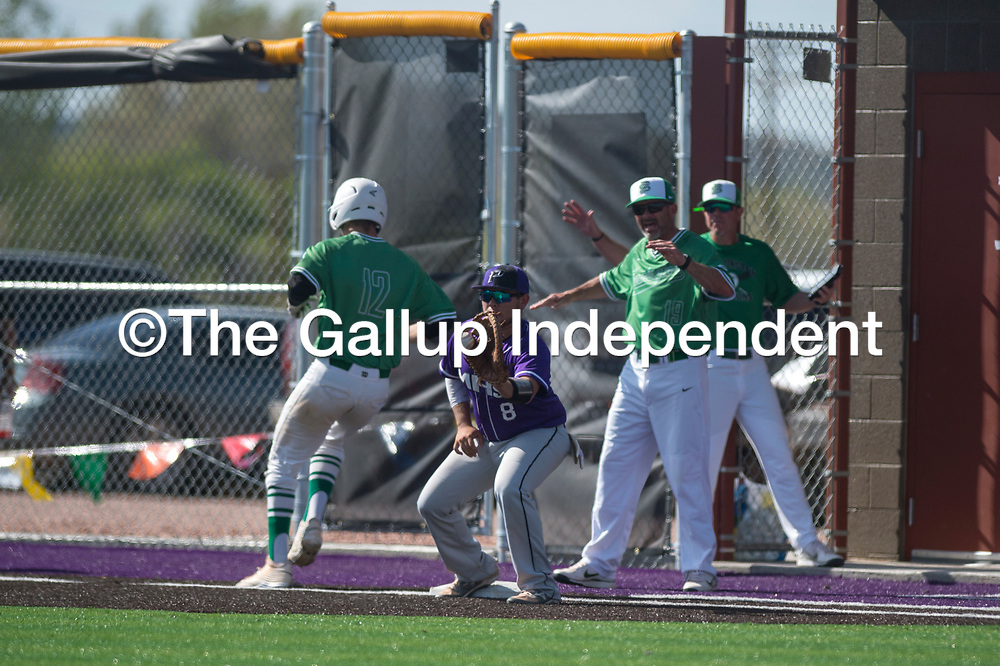 Miyamura Patriot Ozzie Guerreo (8) catches the ball at first base after Farmington Scorpion Isaiah Royce (12) touched the base Friday in Gallup.