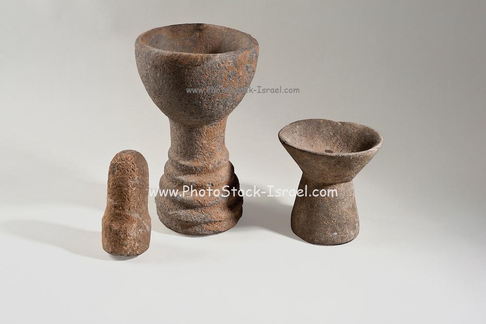 A Chalcolithic (Copper age) Basalt pedestalled bowl with pestle.  4th Millennium BCE