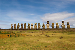 Chile, Easter Island: Array of statues or moai on a platform or ahu at Ahu Tongariki, near the quarry Rano Raruku.  This is the largest array of moia on Easter Island, consisting of 15 moai..Photo #: ch249-33845..Photo copyright Lee Foster www.fostertravel.com lee@fostertravel.com 510-549-2202