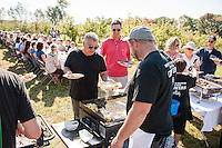 "Local Eatery's Glenn LeClair and Chef Kevin Halligan serve up sweet potatoes with smoked chicken and arugula along with a ham, cheddar and apple omelet during the ""Breakfast at the Orchard"" Sunday morning at Smith's Orchard in Belmont.  (Karen Bobotas/for the Laconia Daily Sun)"