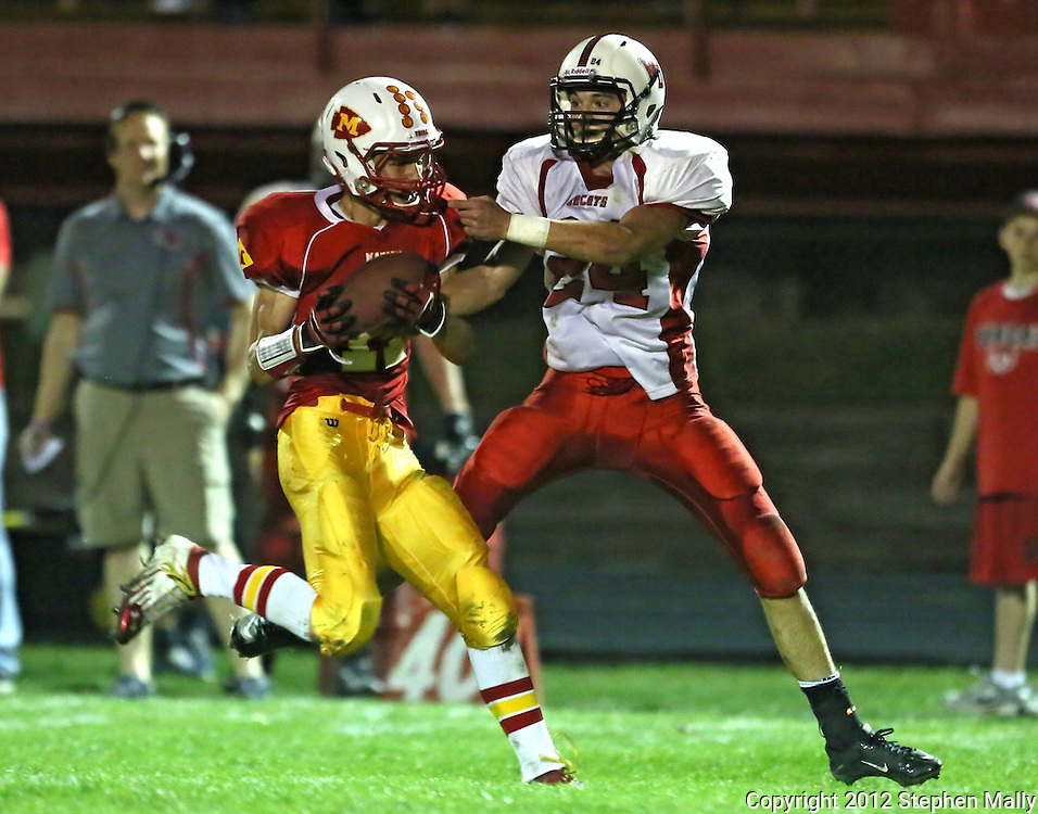 Marion's Quinn Cannoy (11) intercepts a pass intended for Western Dubuque's Dylan James (24) during their first round playoff game at Thomas Park Field in Marion on Wednesday, October 24, 2012.