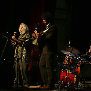 BREVARD, NC - SEPTEMBER 12 : David Grisman performs with his Quintet  - including l-r Matt Eakle on flute, Grant Gordy on guitar, and George Marsh on drums - in the Mountain Song Festival at The Brevard Music Center on September 12, 2009,  in Brevard, North Carolina, USA. (Photo by Logan Mock-Bunting/Getty Images)
