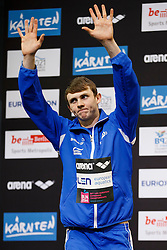 Ross Murdoch of Great Britain collects his Silver medal on the podium for the Mens 100m Breaststroke Final - Photo mandatory by-line: Rogan Thomson/JMP - 07966 386802 - 19/08/2014 - SPORT - SWIMMING - Berlin, Germany - Velodrom im Europa-Sportpark - 32nd LEN European Swimming Championships 2014 - Day 7.