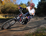 DETROIT, MICHIGAN - USA -  A woman downhill mountain bike rider rides through a bermed corner. (Photo by Bryan Mitchell)