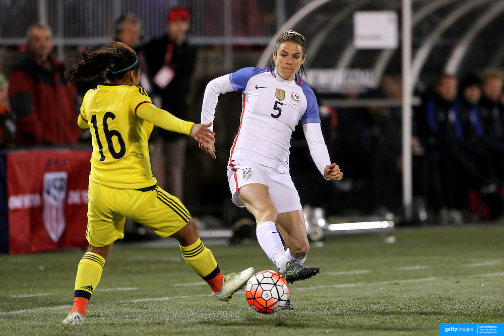 Kelley O'Hara, (right), USA, is challenged by Leicy Santos, Colombia, during the USA Vs Colombia, Women's International friendly football match at the Pratt & Whitney Stadium, East Hartford, Connecticut, USA. 6th April 2016. Photo Tim Clayton