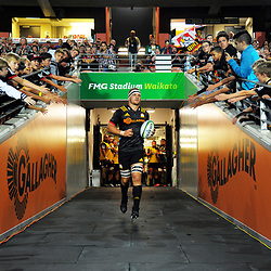 Chiefs centurion Sam Cane leads his team out for the Super Rugby match between the Chiefs and Highlanders at FMG Stadium in Hamilton, New Zealand on Friday, 30 March 2018. Photo: Dave Lintott / lintottphoto.co.nz