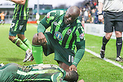 Bayo Akinfenwa of AFC Wimbledon congratulates Ade Azeez of AFC Wimbledon during the Sky Bet League 2 match between Barnet and AFC Wimbledon at Underhill Stadium, London, England on 20 February 2016. Photo by Stuart Butcher.