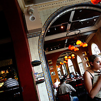 ST. PETERSBURG, FL -- June 29, 2008 --Waiters and waitresses tend to their tables in the front dining area of Ceviche, a popular Spanish restaurant of the newly renovated Ponce de Leon Hotel in downtown St. Petersburg, Fla., on Sunday, June 29, 2008.  St. Petersburg's downtown is thriving with new shops, restaurants, and bars that are feeding off a younger, energetic crowd that fills its walkable map pinpointed with rejuvenated historic hotels and condos.