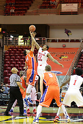 21 November 2015: Ed Crenshaw tosses up the ball for Josh Ibarra(44) and Deontae Hawkins(23) to begin the game. Illinois State Redbirds host the Houston Baptist Huskies at Redbird Arena in Normal Illinois (Photo by Alan Look)