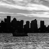 Boston skyline panorama black and white photo. with Boston Harbor. Boston Massachusetts is a major city along the Atlantic Ocean on the East coast of the United States.