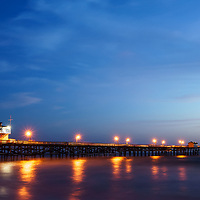 Panoramic photo of San Clemente California pier at sunset. San Clemente is a coastal city along the Pacific Ocean in Orange County Southern California in the USA. Copyright ⓒ 2017 Paul Velgos with All Rights Reserved.