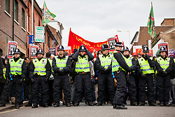 Luton, UK. 5th May, 2012. Police officers form a cordon in front of supporters of Unite Against Fascism attending the We Are Luton/Stop The EDL march, held in protest against a march by around 3,000 supporters of the far-right English Defence League. Around 1,500 police were deployed in Luton for the rival marches from twenty forces around the UK.