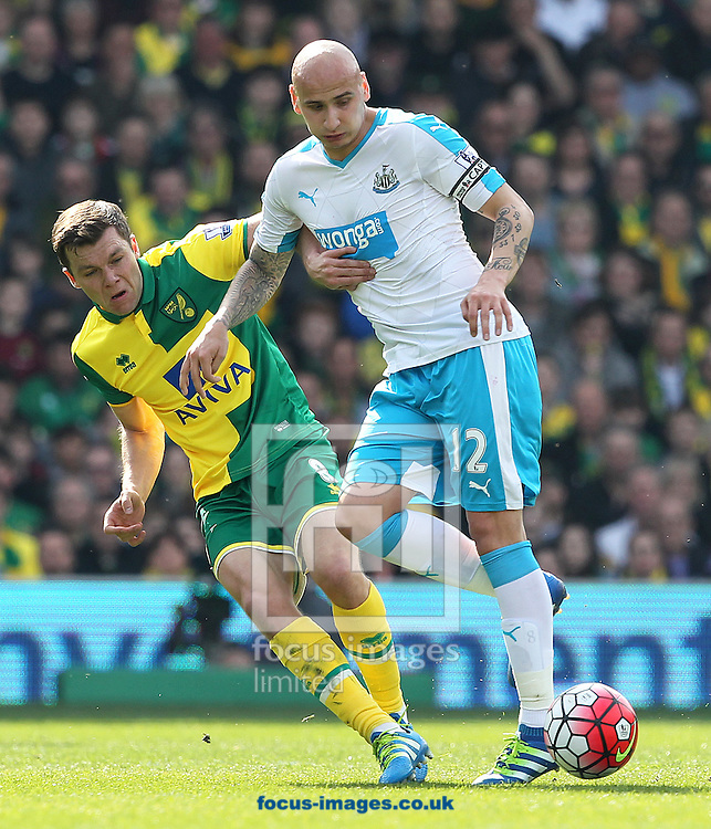 Jonny Howson of Norwich and Jonjo Shelvey of Newcastle United in action during the Barclays Premier League match at Carrow Road, Norwich<br /> Picture by Paul Chesterton/Focus Images Ltd +44 7904 640267<br /> 02/04/2016
