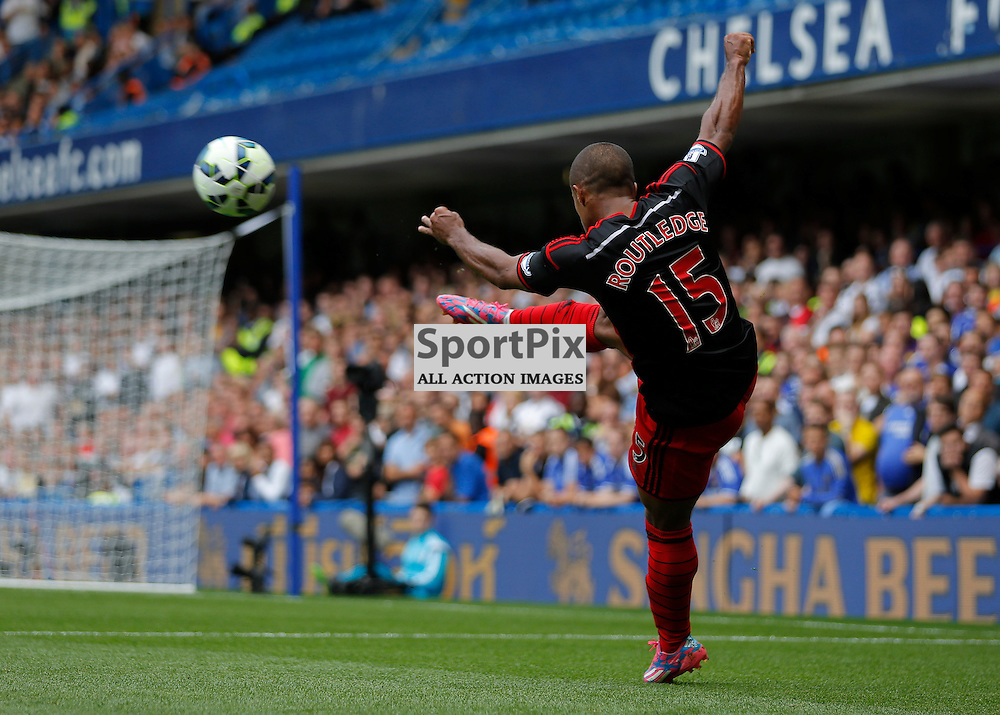 15 MF Wayne Routledge clears the ball with a volley | Chelsea v Swansea City - Stamford Bridge -  Barclays Premier League - 13/09/2014  | Andy Walter (c) Sportpix.org