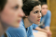 03/21/2014- Stevens Point, Wisc. - Tufts guard Hannah Foley, E15, listens to head coach Carla Berube's pre game briefing before their NCAA Division III Women's Final Four game against FDU-Florham at Quandt Fieldhouse on Mar. 21, 2014. (Kelvin Ma/Tufts University)