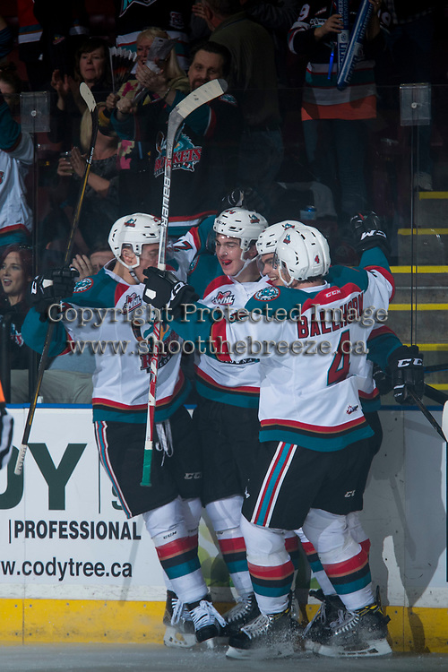 KELOWNA, CANADA - MARCH 25: Calvin Thurkauf #27, Cal Foote #25, Nick Merkley #10 and Gordie Ballhorn #4 of the Kelowna Rockets celebrate a first period goal against the Kamloops Blazers on March 25, 2017 at Prospera Place in Kelowna, British Columbia, Canada.  (Photo by Marissa Baecker/Shoot the Breeze)  *** Local Caption ***