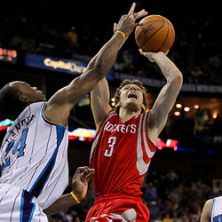 April 19, 2012; New Orleans, LA, USA; Houston Rockets point guard Goran Dragic (3) shoots over New Orleans Hornets power forward Carl Landry (24) during overtime at the New Orleans Arena. The Hornets defeated the Rockets 105-99.   Mandatory Credit: Derick E. Hingle-US PRESSWIRE