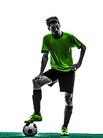 one soccer football player young man standing in silhouette studio on white background
