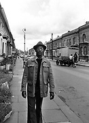 Photo of Linton Kwesi Johnson (LKJ) on Railton Road Brixton - Race Today office 1979