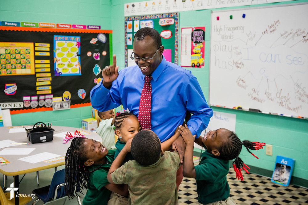 Students hug teacher Jonathan Clausell near the end of class at Trinity Evangelical Lutheran School on Monday, April 7, 2014, in Mobile, Ala. LCMS Communications/Erik M. Lunsford