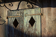 Weathered shutters with iron hinges in the French Quarter of New Orleans, Louisiana.
