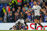 Chelsea midfielder Jorginho (5) takes out Valencia midfielder Geoffrey Kondogbia (6), yellow card, during the Champions League match between Chelsea and Valencia CF at Stamford Bridge, London, England on 17 September 2019.