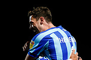 Ben Heneghan of Blackpool F.C. celebrates the goal scored by Armand Gnanduillet of Blackpool F.C. during the EFL Sky Bet League 1 match between Doncaster Rovers and Blackpool at the Keepmoat Stadium, Doncaster, England on 17 September 2019.
