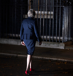 © Licensed to London News Pictures. 14/11/2018. London, UK. British Prime Minister THERESA MAY returns to Downing Street following a statement outside 10 Downing Street in London after presenting a Brexit deal to Cabinet. Photo credit: Ben Cawthra/LNP