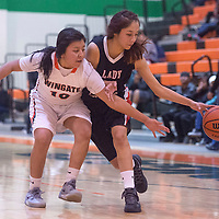 Wingate Bear Dellena Payton (10) attempts to steal the ball from Crownpoint Eagle Daliah Begay (23) Wednesday in Wingate.