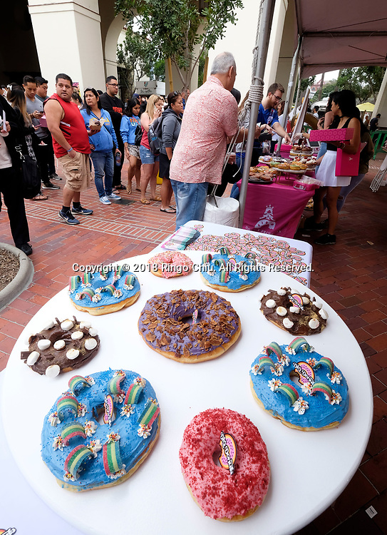 Variety giant donuts are displayed at the inaugural DTLA Donut Festival at Union Station in Los Angeles on Saturday, June 16, 2018. (Photo by Ringo Chiu)<br /> <br /> Usage Notes: This content is intended for editorial use only. For other uses, additional clearances may be required.