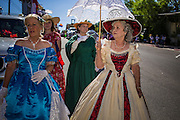 30 JUNE 2012 - PRESCOTT, AZ: Women in period dress at the Prescott Frontier Days Rodeo Parade. The parade is marking its 125th year. It is one of the largest 4th of July Parades in Arizona. Prescott, about 100 miles north of Phoenix, was the first territorial capital of Arizona.    PHOTO BY JACK KURTZ