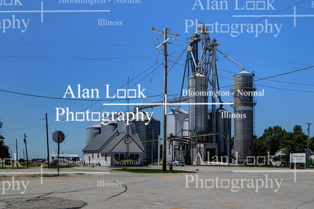 31 July 2015:  Arrowsmith Illinois. A grain elevator in a midwest town is needed for trade and to keep the agricultural breadbasket of the world functioning.  They also double as landmarks and help to give small communities identities.  They are often thought of as midwestern skyscrapers as they can define a skyline and are often taller than even a towns water tower.<br /> <br /> <br /> This image was produced in part utilizing High Dynamic Range (HDR) processes.  It should not be used editorially without being listed as an illustration or with a disclaimer.  It may or may not be an accurate representation of the scene as originally photographed and the finished image is the creation of the photographer.