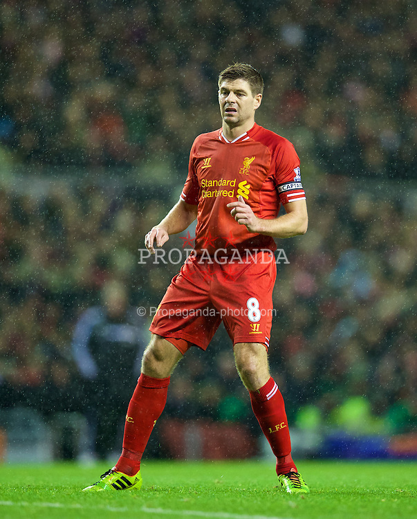 LIVERPOOL, ENGLAND - Wednesday, January 1, 2014: Liverpool's captain Steven Gerrard in action against Hull City during the Premiership match at Anfield. (Pic by David Rawcliffe/Propaganda)