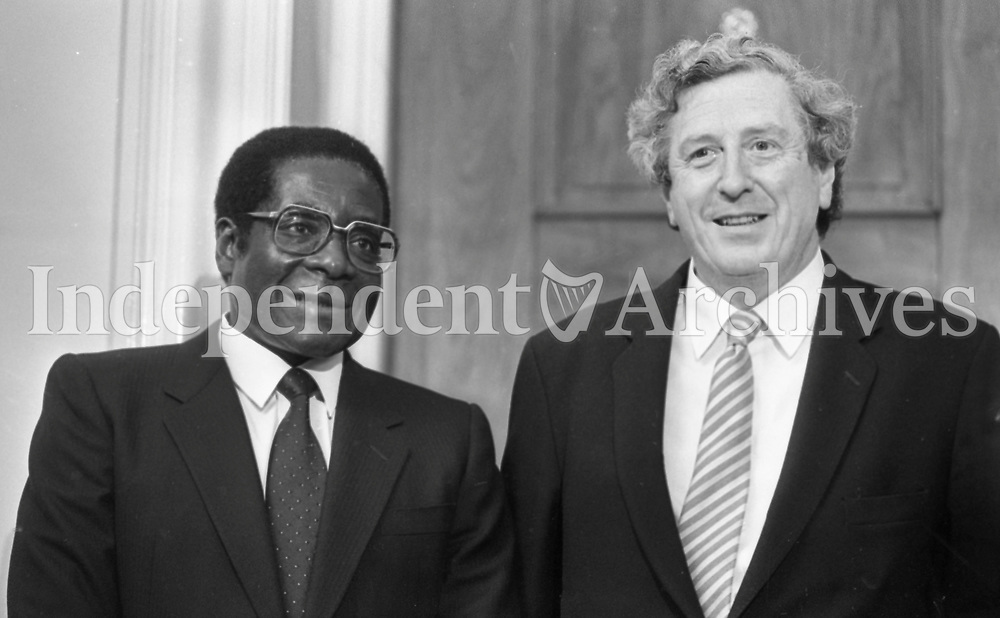 President of Zimbabwe Robert Mugabe with former Taoiseach of Ireland Garrett Fitzgerald at a State reception at Dublin Castle during Mugabe's three-day visit to Ireland in September 1983. (Part of the Independent Newspaperrs Ireland/NLI Collection)